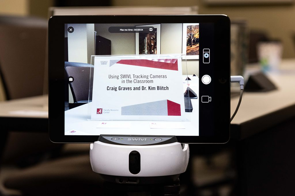 "Swivl tracking cam displays image of presentation sign reading ""Using SWIVL Tracking Cameras in the Classroom"""